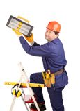 Worker on ladder with hammer Royalty Free Stock Photo