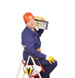 Worker on ladder holding toolbox. Royalty Free Stock Image
