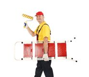 Worker with ladder and roll. Royalty Free Stock Image