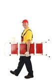 Worker with ladder smiling. Stock Photos