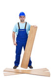 Worker with laminate flooring Royalty Free Stock Photos