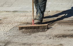 Worker with large scrub brush collect residues Royalty Free Stock Image