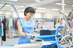 Worker Laundry ironed clothes iron dry Stock Photo