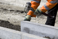 Worker laying breeze blocks Stock Photo