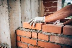 Worker laying bricks on exterior walls Royalty Free Stock Photo