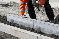 Worker laying stones Royalty Free Stock Photo