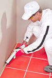 Worker lays silicone gun sealant Stock Photography