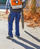 Worker with leaf blower Stock Images