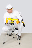 Worker level measured with a laser level Stock Photography