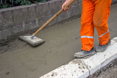 Worker leveling fresh Concrete  Royalty Free Stock Photography