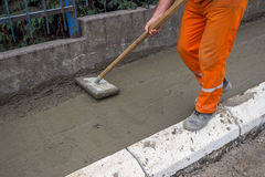 Worker leveling fresh Concrete  Stock Images