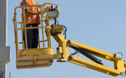 Worker in lifting platform Royalty Free Stock Photo