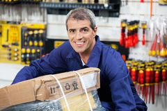 Worker Lifting Tool Package In Hardware Shop Royalty Free Stock Image