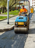 Worker on light vibration roller compactor Royalty Free Stock Images