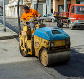 Worker on light vibration roller compactor Royalty Free Stock Photo