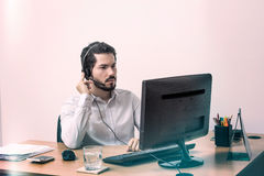 Worker listening very carefully Royalty Free Stock Photography