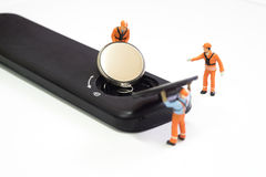 Worker loading battery Stock Photos