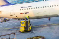 Worker loads cargo to aircraft in Frankfurt Stock Images