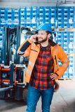 Worker in logistics warehouse on the phone. Receiving instructions stock photo
