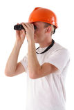 Worker looking through binoculars. Isolated on white Royalty Free Stock Photo