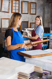 Worker Looking At Coworker Making Papers In Royalty Free Stock Photo