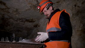 Worker looking drawings in the cave stock video