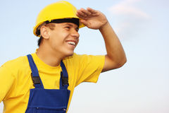 Worker looking forward, covering eyes from the sun Stock Photo