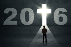 Worker looking at numbers 2016 and a cross symbol Stock Image