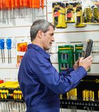 Worker Looking At Packed Product In Hardware Store Stock Images