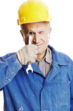 Worker looking through screw key Stock Image