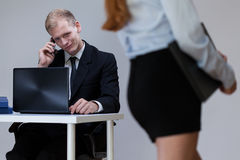 Worker looking at woman stock photography