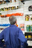 Worker Looking At Tools In Hardware Store Stock Images