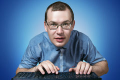 IT Worker looking at you. On the blue background Royalty Free Stock Image