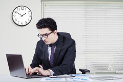 Worker looks concentration working in office Stock Photos