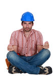 Worker in the lotus position. Royalty Free Stock Images