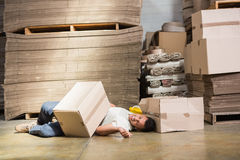 Worker lying on the floor Royalty Free Stock Image