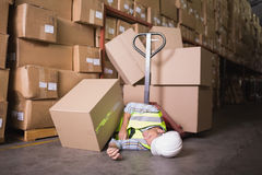 Worker lying on the floor in warehouse. View of male worker lying on the floor in warehouse Stock Photo