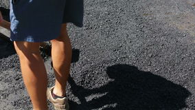 Worker lying hot asphalt. Workers are lying black hot asphalt at a road construction stock video footage