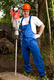 Worker with a machine drill. Worker holding a machine drill royalty free stock photography