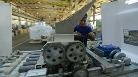 Worker At Machine On Factory stock video footage