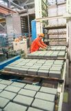 Worker at machine on stone blocks drying Royalty Free Stock Image