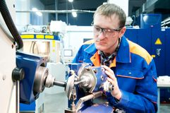 Worker at machine tool operating Stock Photos