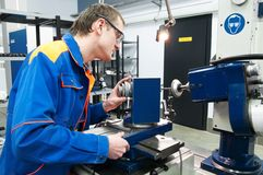 Worker at machine tool operating Stock Image