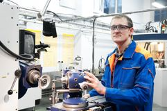 Worker at machine tool operating Royalty Free Stock Photos