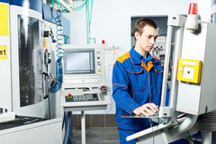 Worker at machine tool in workshop Royalty Free Stock Images