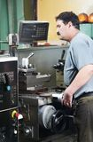 Worker at machining tool workshop Royalty Free Stock Photo