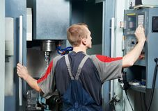 Worker at machining tool workshop Stock Image