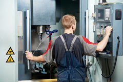Worker at machining tool workshop Royalty Free Stock Image