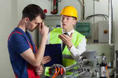 Worker made a mistake in a factory. Horizontal royalty free stock photography