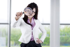 Worker with magnifier near the window royalty free stock image